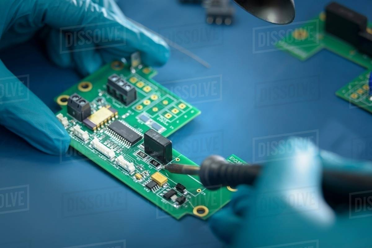 Groovy Worker Soldering Circuit Board In Electronics Factory Close Up Wiring Cloud Ittabisraaidewilluminateatxorg